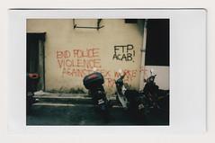 (Hem.Odd) Tags: violence police wall message motorbike motorcycle malaysia kualalumpur instaxmini90 instant fujifilm