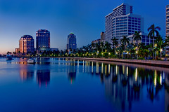 City of West Palm Beach, Palm Beach County, Florida, USA (Photographer South Florida) Tags: westpalmbeach palmbeachcounty city cityscape urban downtown skyline southflorida density centralbusinessdistrict skyscraper building architecture commercialproperty cosmopolitan metro metropolitan metropolis sunshinestate realestate highrise royalparkbridge townofpalmbeach palmbeach clearlake longexposure bluehour palmtrees dawn