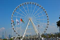 Marina Mall, Abu Dhabi (Seventh Heaven Photography *) Tags: marina mall corniche road abu dhabi uae united arab emirates wheel flags blue sky ferris nikond3200
