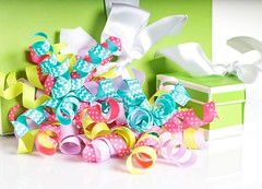 Birthday Trimmings (Karen_Chappell) Tags: birthday gift present ribbon parcel package green white stilllife holiday yellow pink blue ribbons trim decor curly curls curl polkadots stripes