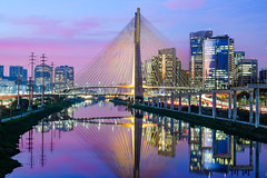 Ponte Estaiada Noite Colorida (www.capacitymedia.com) Tags: sao paulo brazil bridge sunset night skyline landmark famous city cityscape building architecture water downtown skyscraper buildings sky river panorama urban business travel landscape reflection view estaiada pinheiros