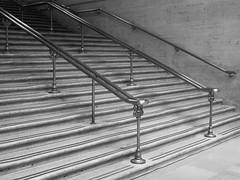 Worn Stairs (Nick Condon) Tags: blackandwhite chicago olympus25mm olympusem10 railings shadow stairs unionstation absoluteblackandwhite olympus