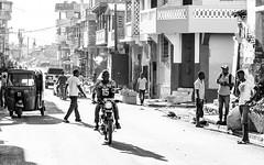 Moto-Taxi on the Prowl, B&W, Cap Haitien, Haiti (MikeM_1201) Tags: haiti caphaitien d500 bw monochrome rue street sunlit threewheeler tuktuk morning mototaxi