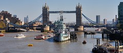Warship centred on bridge - River Thames, London SE1.. (edk7) Tags: nikond610 nikonafnikkor28105mm13545d edk7 2015 uk england london riverthames pooloflondon hmsbelfast imperialwarmuseumhistoricvessel warship ship boat londonboroughofsouthwark southwark southbank towerbridge bridge architecture building oldstructure city cityscape urban stonecarving gradeilisted pier water sky