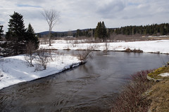 Winter Stream (Northern Wolf Photography) Tags: 17mm clouds em5 grass ice olympus snow spring stream water winter pittsburg newhampshire unitedstatesofamerica us