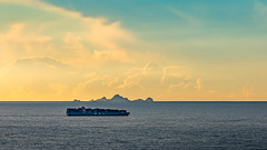 Cargo ship passing in front of the Farallon Islands. Pacifica, CA. (j1985w) Tags: california pacifica ocean water sunset sky clouds islands farallonislands ship