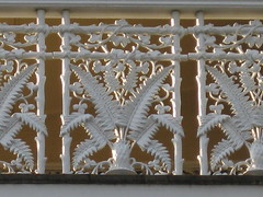 Cast Iron Lacework Detail of Goodrest Mansion; Toorak Road, South Yarra (raaen99) Tags: goodrest goodrestmansion simmondshall mansion largehouse housename christchurchgrammarschool christchurchsouthyarra estate house home fawknerpark southyarra toorakrd toorakroad melbourne victoria australia victoriana nineteenthcentury 19thcentury 1884 1880s victorianitalianate italianate architecture williampartonbuckhurst williambuckhurst walterbuckhurst architecturaldesigned historic nationaltrust heritagelisted mansard tower mansardroof widowswalk wroughtiron slatetiles slate rooftiles finial verandah iron castiron lacework fretwork white yellow victorianitalianatearchitecture victorianitalianatebuilding boomstylearchitecture boomstyle boomstylebuilding stucco stuccoedbrick brick archedwindow boomperiod marvellousmelbourne column pillar baywindow window windows portico decoration balustrade mouldings entrance domesticarchitecture