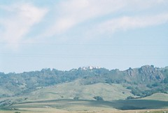 CNV00016 (rugby#9) Tags: hearstcastle outdoor landscape hill mountainside rock rockformation foothill cliff crag us america california sky cloud tree trees sansimeon