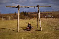 IMG_9182 (klakeduker) Tags: western ukraine girl swing hills spring march canon 6d hat black jacket wheel chain log landscape horizon clouds sun borschivka