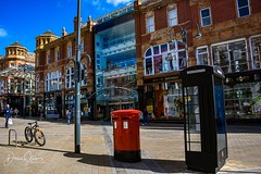 PSX_20190324_204944 (ShakeyDave) Tags: briggate leeds street telephone box post bike city sun march 2019 blue sky sunday