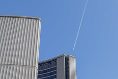 Plane passing over the 6ix.  Toronto City Hall in the foreground. (Villagemayor) Tags: contrails airplane toronto downtown urbanism urban cityhall canon m50
