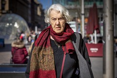 Cross (Leanne Boulton) Tags: urban street candid portrait portraiture streetphotography candidstreetphotography candidportrait streetportrait eyecontact candideyecontact streetlife old woman female lady face eyes expression mood emotion feeling cross scarf colourful tone texture detail depthoffield bokeh naturallight sunlight light shade shadow city scene human life living humanity society culture lifestyle people canon canon5dmkiii 70mm ef2470mmf28liiusm color colour glasgow scotland uk