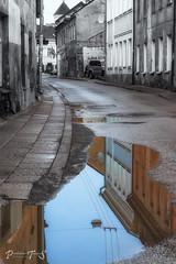 Reflections (Prohibere Tempus) Tags: lietuva lithuania vilnius canon city reflection street puddle coloursplash building buildings urban urbanphotography streetphotography architecture sky pavement