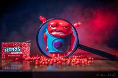Sweet Revenge 7/52 (stevemolder) Tags: eosr canon 52 weeks atmosphere aerosol toys toy nerds red blue gel strobist magnifying glass smoke vello impact soft box speedlite 430ex 580ex