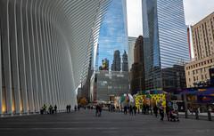 Reflecting (Jocey K) Tags: sonydscrx100m6 triptocanadaandnewyork architecture buildings autumn reflections sky street mural people oculus worldtradecentertransportationhub