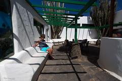 Midday shadow (piotr_szymanek) Tags: marzka woman milf portrait outdoor shadow wall bench face eyesoncamera shorts glasses sunglasses hand 1k 5k 10k 20f