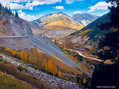 View Back to Silverton Down the Million Dollar Highway, Colorado, USA (Black Diamond Images) Tags: silverton milliondollarhighway colorado usa cloud clouds milliondollarhwy fallcolor appleiphonex iphonexbackcamera iphonex iphone westernusatrip2018 2018 sky mountain autumncolour autumncolor autumn sanjuanskyway hwy550 tree wood forest landscape road mountainside sanjuanmountains redmountain aspens colourfultrees co grass screeslope field highway550