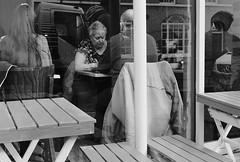Lorry in the Cafe (Bury Gardener) Tags: burystedmunds bw blackandwhite britain monochrome mono 2019 suffolk streetphotography street streetcandids snaps strangers candid candids people peoplewatching folks fuji fujixt3 england eastanglia uk buttermarket
