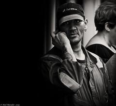 Zotto and the Dangerous man. (Neil. Moralee) Tags: neilmoralee neilmoraleeolympuscandidhonitondevon man face portrait phone mobile hat dark black white bw bandw blackandwhite mono monochrome neil moralee olympus em5 omd dangerous zotto shadow sinister honiton devon street candid style telephone cell nasty wicked tatoo peak eye eyes vivid