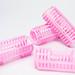 Pink hair curler tubes