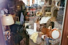 Negative0-12-12A(1) (simona_stoeva) Tags: film analog 35mm canon ae 1 vienna travel trip city street antique shop window store