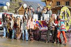 The Peace Float (wyojones) Tags: montana whitefish feburary wintercarnival woodstockwhitefish 60s 1969 vintage tyedye glasses peacesymbol bellbottoms fringe woman girl chick dude hair brunette redhead blonde longhair dog bulldog bus flowerpower peacesign love wagon paisley costumes hats colors sunglasses hippies parade float solarpanels wyojones