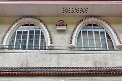 Art Deco arched windows. Office building on General Luna-Real sts.corner-Intramuros-Manila-Philippines-0957 (rweisswald) Tags: facade arch arched doubleleaf casementwindow glazed glazing glass paned section pane mullion transom light pair couple wall house officebuilding commercial edifice artdeco style decoration ornate closed intramuros walledcity innercity redtile canopy cornice roof walllight sconce lightfixture realstreet generallunastreet oscarledesma electricalwire cable powerline electricity venetian blind curtain transparent translucent manila philippines