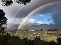 Rainbow and a patch of blue (EXPLORE) (avilacats) Tags: winter vista rainclouds spectrum doublerainbow sanmarcospass explore rainbow