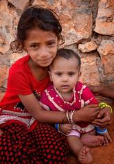 Socotri Girls (Rod Waddington) Tags: middle east socotra island yemen yemeni socotri girls children traditional tribe tribal islam portrait people outdoor rock wall house village