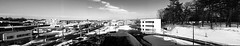 Panorama Eastwards from the Kitahiroshima City Hall Building 3 (sjrankin) Tags: 18february2019 edited kitahiroshima hokkaido japan snow ice weather sky cityhall clouds buildings parkinglot cars roads stores grayscale panorama