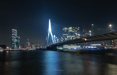 City of the future. (rudi.verschoren) Tags: erasmus bridge futuristic future night long exposure colors colorful contrast cold canal maas buildings architecture new europe europa evening art reflection river tall sky urban infrastructure outdoor overlooking panorama quay dusk dawn netherlands holland landscape cityscape mood water