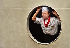 Ships Cook - Taking a Break (Mr_Pudd) Tags: themanwithnolegs round circle porthole paint steel ship chef chongqingprovince yangtzecruise yangtze xiaoxibrook nikond750 nikon china chongqing 31017466110008016 xiaoxi gorge brook xiaoxigorge