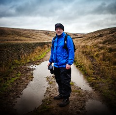 Trev (Missy Jussy) Tags: trevorkerr trev man portrait walk walkinglandscape landscape lancashire land hills path puddle camera photographer sky backlit moors wall readycondeanreservoir saddleworth northwest england pennines 24mm ef24mmf28 canon5dmarkll canon5d canoneos5dmarkii canon outdoor outside countryside grass