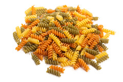 Colorful macaroni isolated above white background (wuestenigel) Tags: dry color mediterranean background dinner red carbohydrate uncooked italian cook pile meal yellow white raw market whole closeup cooking focus macaroni healthy diet studio gourmet food fusilli ingredient wheat cuisine heap lunch macro green fresh tasty pasta staple