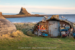Herring boat shed on Holy Island Northumberland (john@johnrobertsimages.co.uk) Tags: grass hut landscape seashore water cabin outdoor sea beach ocean herring shed hovel sky boat coast shelter daylight building rural shore countryside northumberland watercraft travel shanty hutch island shack outbuilding holy outdoors 3x2 vessel