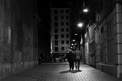 Night street (Daniel Nebreda Lucea) Tags: night noche city ciudad calle street noir life vida walking andando dark oscuro darkness oscuridad light luz lights luces shadow sombra shadows sombras architecture arquitectura building edificio old viejo antiguo urban urbano town pueblo nocturna canon 60d 50mm composition composicion atmosphere atmosfera love amor people gente ciudades zaragoza casco streets calles fear miedo black white blanco negro monochrome monocromatico bw grey monocromo gris stranger extraños couple pareja ancianos valentine anciants viejos