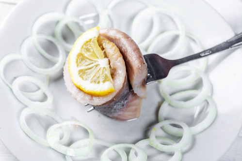 Herring marinated fillet with onion and lemon