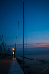 Out At Sea, Be'eld the Dock-Lights Die—R Kipling (ioannis_papachristos) Tags: dock quay pier wharf promenade sea seascape seaside seashore docks bluehour twilight dusk sunset dark lowkey chiaroscuro thessaloniki greece seas sail ships masts docked hasty walk femalefigure buoy green twilightworld papachristos canon mirrorless eosm50 poetry poem poet kipling rudyardkipling rkipling sestina tramproyal verticalorientation portraitformat longexposure photogenic art macedoniagreece makedonia macedoniatimeless macedonian macédoine mazedonien μακεδονια македонијамакедонскимакедонци