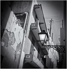 Lomography (Black and White Fine Art) Tags: farol lamp lomography lomografia plasticcamera camaraplastica toycamera camaradejuguete sanjuan oldsanjuan viejosanjuan puertorico perspective perspectiva niksilverefexpro2 lightroom3
