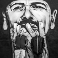 Scott and Noel, Santana Style (Thomas Hawk) Tags: america bayarea california carlossantana mission missiondistrict noelkopp pocketman sf sfbayarea sanfrancisco santana scottjordan scottevest usa unitedstates unitedstatesofamerica westcoast bw graffiti mural fav10 fav25 fav50 fav100