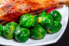 Close-up of Brussels sprouts with baked chicken leg (wuestenigel) Tags: baked delicious cuisine chickenleg traditional healthy closeup cooking brussels sprouts table brown background dinner thigh gourmet holiday grilled vegetables meat homemade prepared cooked poultry food roast roasted meal dish gold white lebensmittel noperson keineperson abendessen kochen köstlich lunch mittagessen nutrition ernährung mahlzeit health gesundheit gesund nahansicht vegetable gemüse gericht diet diät leaf blatt tasty lecker restaurant epicure feinschmecker traditionell