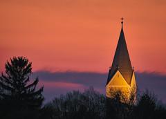 The Garching's Church Tower (redfurwolf) Tags: garching tower church sunset building outdoor tree captureonepro12 redfurwolf sonyalpha bealpha clouds munich germany tamron150600g2 a7rm3 architecture