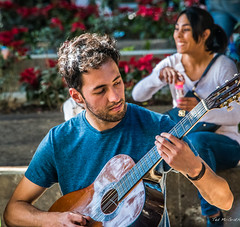2018 - Mexico - Oaxaca - Zocalo Musician (Ted's photos - Returns late Feb) Tags: 2018 cropped mexico nikon nikond750 nikonfx oaxaca tedmcgrath tedsphotos tedsphotosmexico vignetting beard male boy entertainer musician guitar guitarplayer 6stringguitar strumming bokeh oaxacazocalo zocalooaxaca
