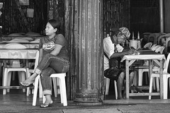 Back to Back (Beegee49) Tags: street man customer writing woman filipina sitting tables chairs restaurant blackandwhite bw monochrome panasonic fz1000 happy planet bacolod city philippines asia luminar happyplanet asiafavorites