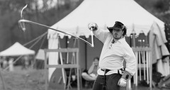 fl2018-0459-bw (skippyclese) Tags: festival fest fair legends renaissance leather whip crack supersonic hat tent pavilion nc north carolina cary nikon d810 outside outdoors