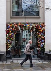 Spring (Spannarama) Tags: theanthologist bar windowdressing flowers framed windows spring man walking greshamstreet london uk