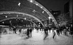 nps_city-hall_ice-rink_skaters_briefcase-man_01bw_8779938084_o (wvs) Tags: christmas cityhall cold concert fireworks holiday ice lights longexposure nathanphillipssquare night nps outdoor panning people pool rink skate snow toronto winter ontario canada can