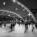 nps_city-hall_ice-rink_skaters_briefcase-man_01bw_8779938084_o