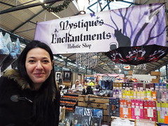 Belfast - Nina at St Georges Market Dec 2018 (sean and nina) Tags: belfast north northern ireland eire irish saint st goeorge georges market stalls indoor inside public items sale people candid merchandise tee shirts fun culture selling sellers shop shopping city centre christmas december 2018 winter nina wife fiancee girlfriend woman female girl lady smile face long dark hair brunette coat brown eyes pink lips smiling gorgeous stunning beauty beautiful charm charming serb