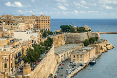 Valletta (Keith in Exeter) Tags: valletta malta wharf harbour mediterranean sea water city capital building architecture tree vehicle road car boat sky